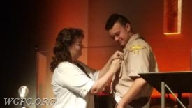 Chris's Mother EMT Kim Miller pinning the Eagle Pin on Chris